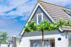 Pediment. View of a modern building with a tiled roof Royalty Free Stock Images