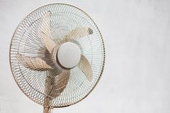 Fan and white wall. Pedistal fan placed before a white wall royalty free stock images