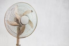 Fan and white wall. Pedistal fan placed before a white wall royalty free stock photo