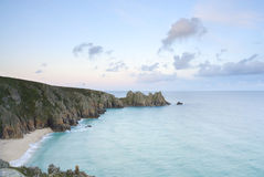 Pedn vounder beach, Cornwall. Pedn vounder beach, one of Cornwall's best beaches with stunning cliffs of Treryn Dinas, crystal clear water and a beautiful sandy stock photo