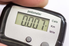 Pedometer in the hand Royalty Free Stock Image