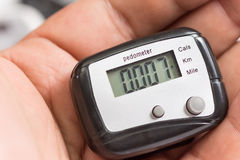 Pedometer in the hand Stock Photography