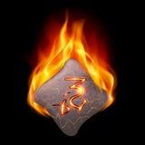 Pedra ardente com runa mágica Imagens de Stock