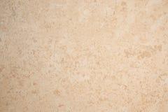Pedra calcária da textura do fundo bronzeado imagem de stock