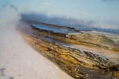 Pedra colorida com mar Foto de Stock Royalty Free