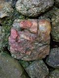 Pedra cor-de-rosa em uma parede Foto de Stock Royalty Free