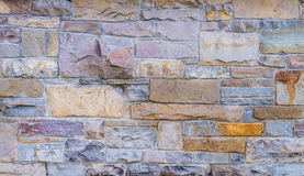 Pedra da parede da textura do fundo imagem de stock