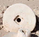 Pedra de moer antiga foto de stock