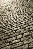 Pedra de pavimentação na luz do por do sol Imagens de Stock Royalty Free