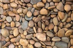 Pedra do rio ou cascalho marrom imagens de stock royalty free