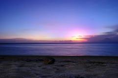 Pedra e praia Imagem de Stock