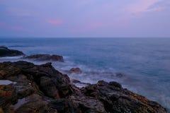 Pedra no mar Imagens de Stock
