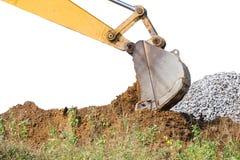 Pedra pesada do solo da escavação do grande backhoe Fotos de Stock Royalty Free