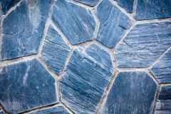 Pedras azuis de uma parede das construções imagens de stock