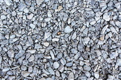 Pedras cinzentas de superfície dos seixos da entulho Fotografia de Stock