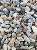 Pedras coloridas no formulário o mais natural imagens de stock royalty free