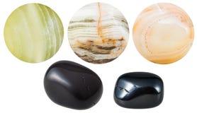 Pedras de gema minerais naturais do ônix preto e de mármore Fotografia de Stock Royalty Free