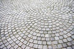 Pedras de pavimentação apresentadas em um teste padrão radial Imagem de Stock Royalty Free