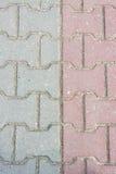 Pedras de pavimentação como um fundo Imagem de Stock