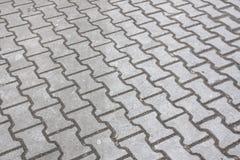 Pedras de pavimentação como um fundo Imagens de Stock Royalty Free