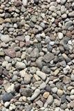 Pedras decorativas em cores diferentes. Imagens de Stock
