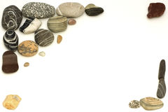 Pedras do mar em um fundo branco Foto de Stock Royalty Free