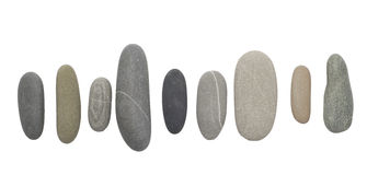 Pedras do seixo no branco fotos de stock