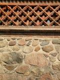 Pedras e parede de tijolo Foto de Stock