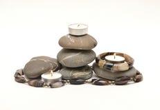 Pedras e velas Imagem de Stock