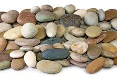 pedras em um fundo branco Foto de Stock Royalty Free