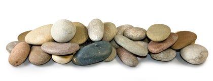 pedras em um fundo branco Fotos de Stock Royalty Free