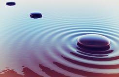 Pedras em uma água Imagem de Stock
