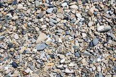 Pedras em uma praia Fotos de Stock Royalty Free