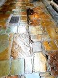 Pedras molhadas da avenida dos pedreiro fotografia de stock royalty free
