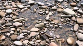 Pedras na água de brilho filme
