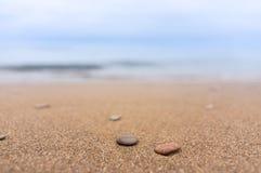 Pedras na areia Foto de Stock