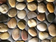 Pedras no concreto Fotografia de Stock Royalty Free