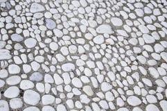 Pedras no solo Foto de Stock Royalty Free