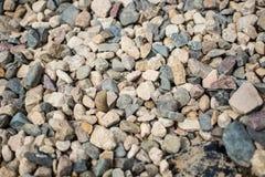 Pedras pela lagoa Imagens de Stock