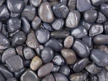Pedras pretas lustradas Imagens de Stock