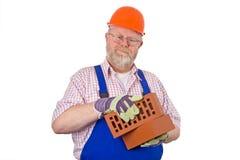 Pedreiro com tijolos Imagens de Stock