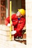 Pedreiro do trabalhador do pedreiro da construção imagens de stock royalty free
