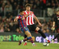 Pedro of FC Barcelona. Pedro of Barcelona and Amorebieta of Bilbao in action during a Spanish League match between FC Barcelona and Athletic Bilbao at the Nou Royalty Free Stock Photos