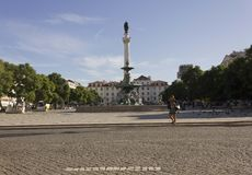 Pedro IV column and fountain in Rossio Square in Lisbon Stock Photos