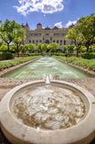 Pedro Luis Alonso gardens and the Town Hall building in Malaga, Royalty Free Stock Photos