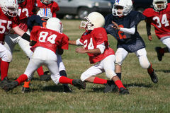 Pee Wee Football. Peewee players bringing down the competition Stock Image