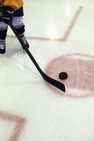 Pee Wee Hockey. A young hockey player with stick and puck Stock Photo
