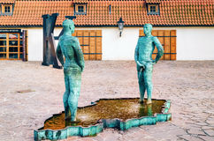 Peeing Statues. PRAGUE, CZECH REPUBLIC - JULY 17, 2012: Peeing Statues, by Czech Sculptor David Cerny beside to the Museum of Franz Kafka in the yard of Royalty Free Stock Photos