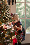 Peek-A-Boo. Little Girl Hiding Behind A Christmas Tree Royalty Free Stock Images