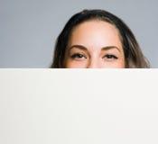 Peek a boo brunette. Stock Images